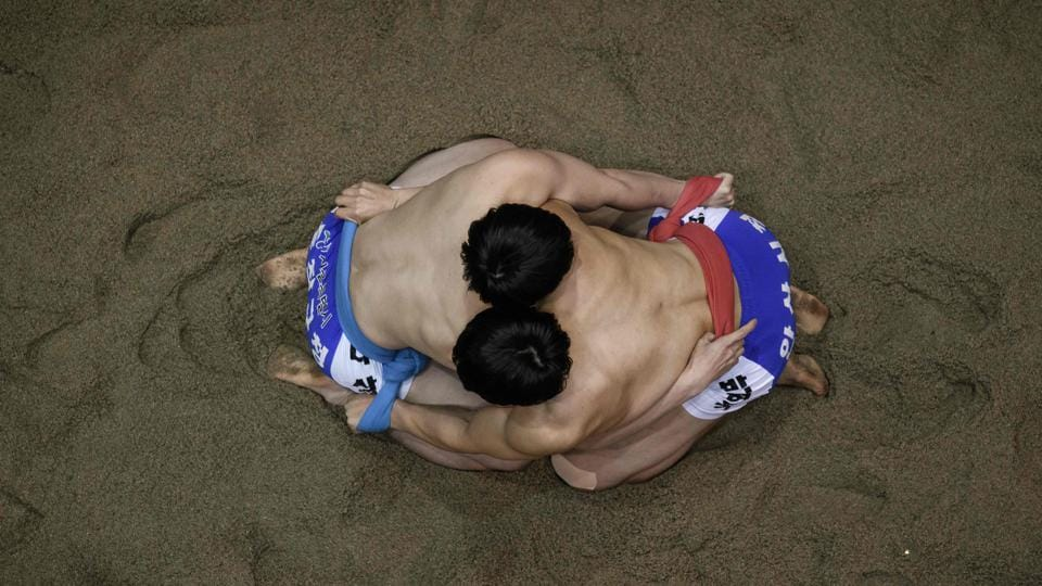 Ssireum wrestlers prepare to compete during the Korea Open Ssireum Festival in Andong, South Korea. North and South Korea have long grappled over their joint symbols at the UNESCO, but they could share the honours this week when twin applications for traditional Korean wrestling come up for consideration. (Ed Jones / AFP)