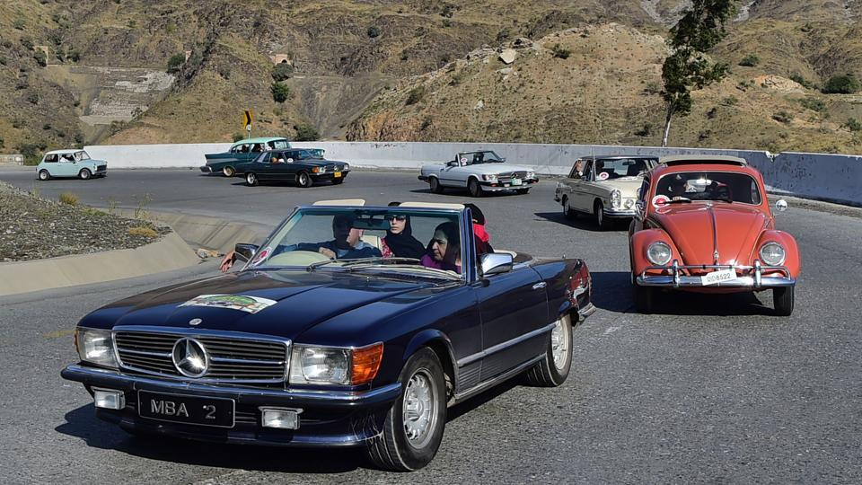 Pakistani people drive vintage cars at the '9th Annual Classic Car Rally 2018' in Landi Kotal, a town in the Khyber Pakhtunkhwa province. (Abdul Majeed / AFP)