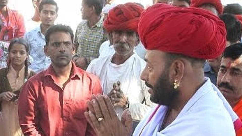 Otaram Dewasi (in maroon headgear) is the BJP candidate from Sirohi in the December 7 Rajasthan Assembly Election. He is also the minister for cow welfare in the Vasundhara Raje cabinet.