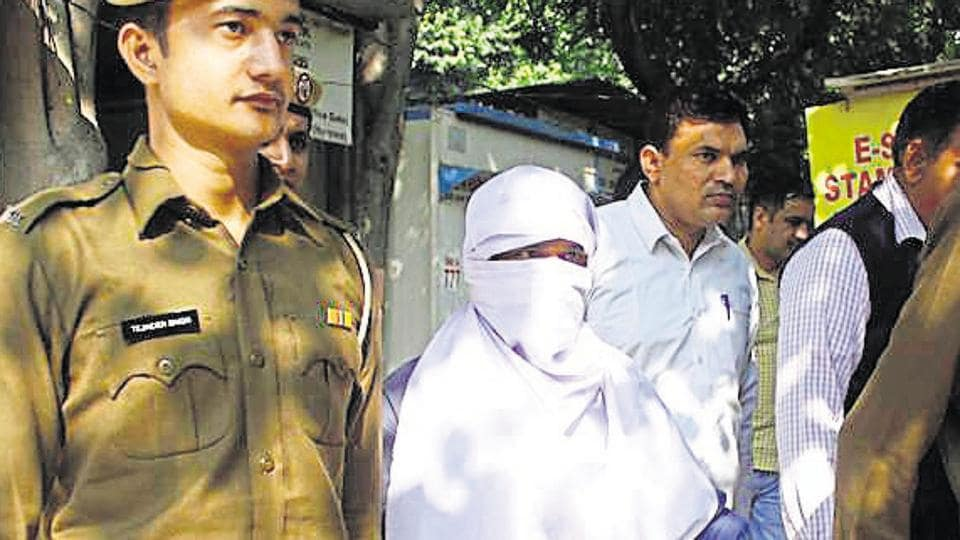 Sunil Kumar (face covered), accused of raping and murdering at least 15 minor girls in Gurugram, Gwalior and Jhansi, was produced before the court after nine days in the custody of the Gurugram police.