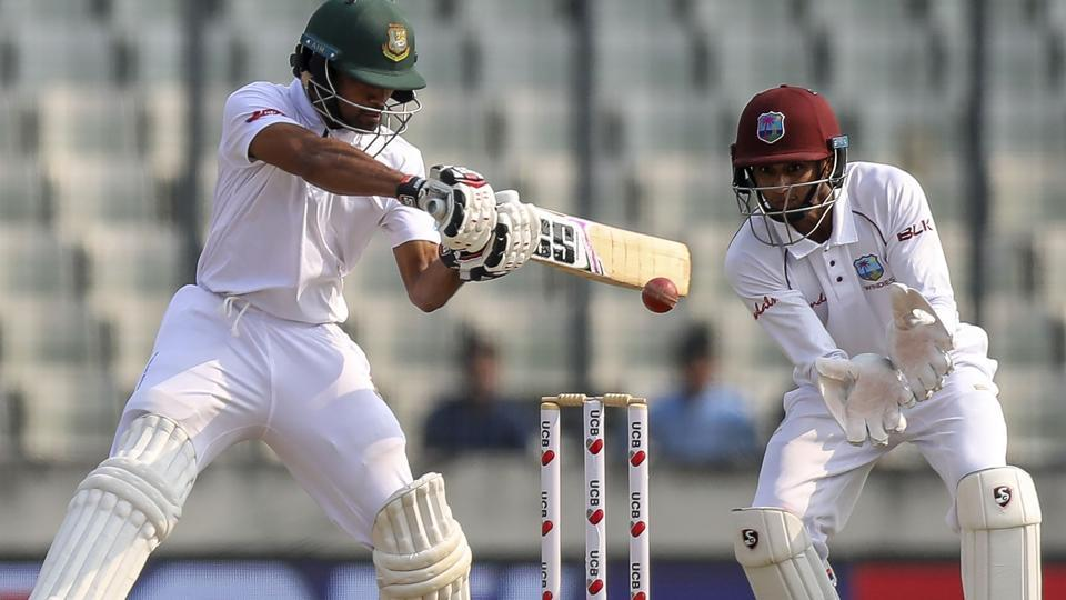 Bangladesh's Shadman Islam (L) plays a shot as West Indies's wicketkeeper Shane Dowrich watches.