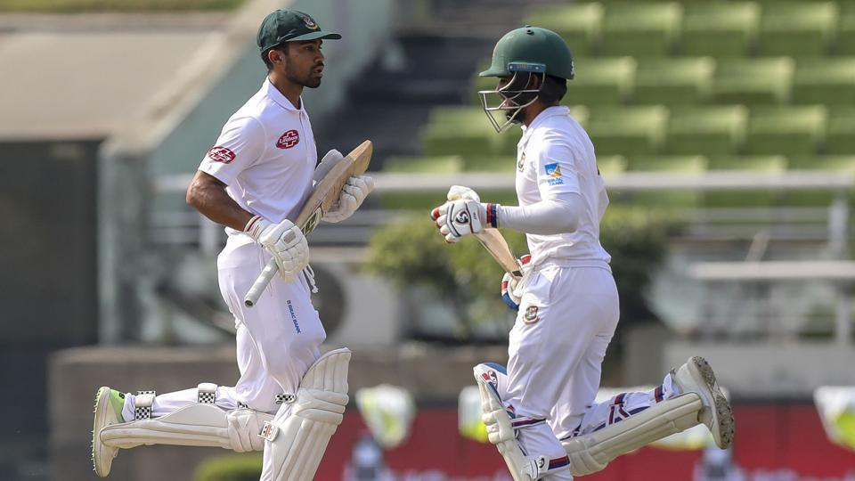 Bangladesh's Mominul Haque (R) and Shadman Islam (L) run between the wickets during the first day of the second Test cricket match between Bangladesh and West Indies in Dhaka on November 30, 2018.
