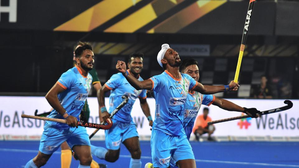 Indiann Mandeep Singh celebrates with teammates after a goal score against South Africa