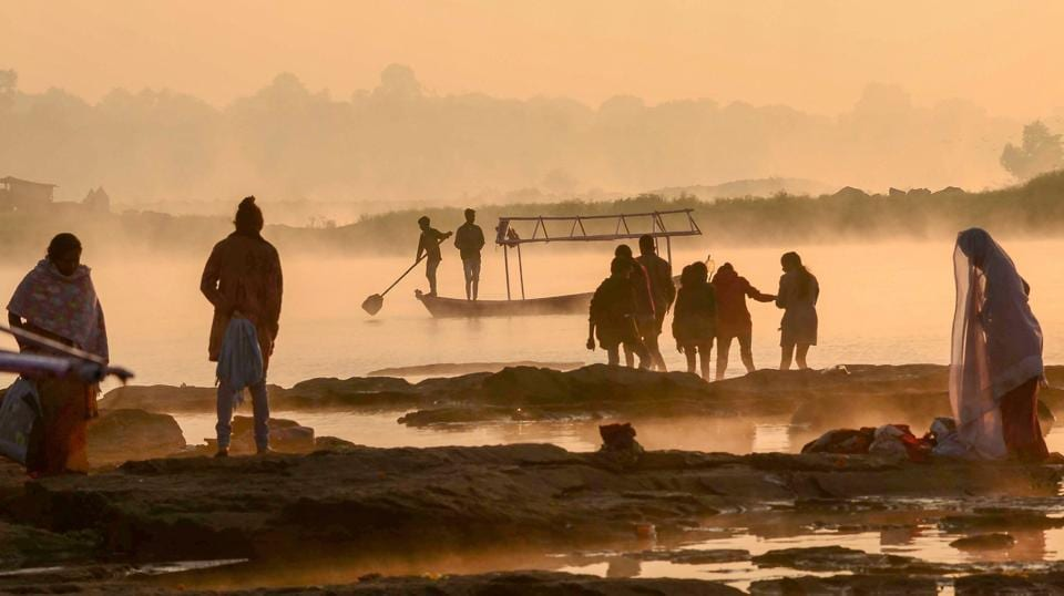 Silhouette of boatmen and others on a winter morning at the bank of river Narmada in Jabalpur, Madhya Pradesh on November 25, 2018. (PTI)