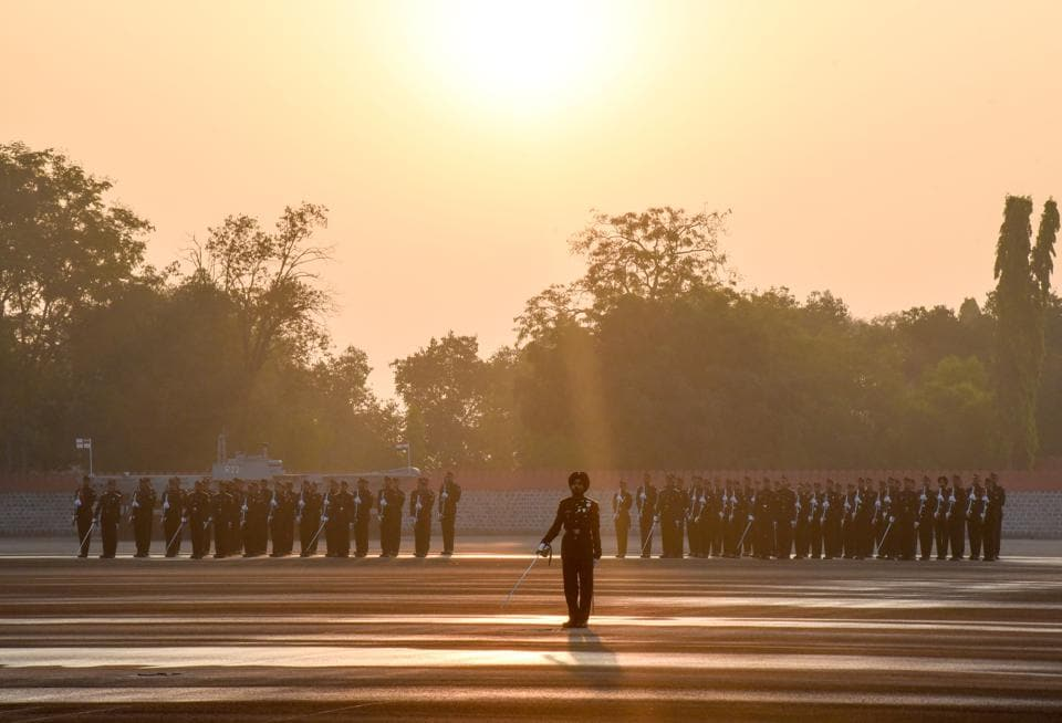 Squadrons come up in a formation on the inspection line at Khetarpal parade ground on the passing out parade of the 135th course of National Defence Academy on Friday. (SANKET WANKHADE/HT PHOTO)