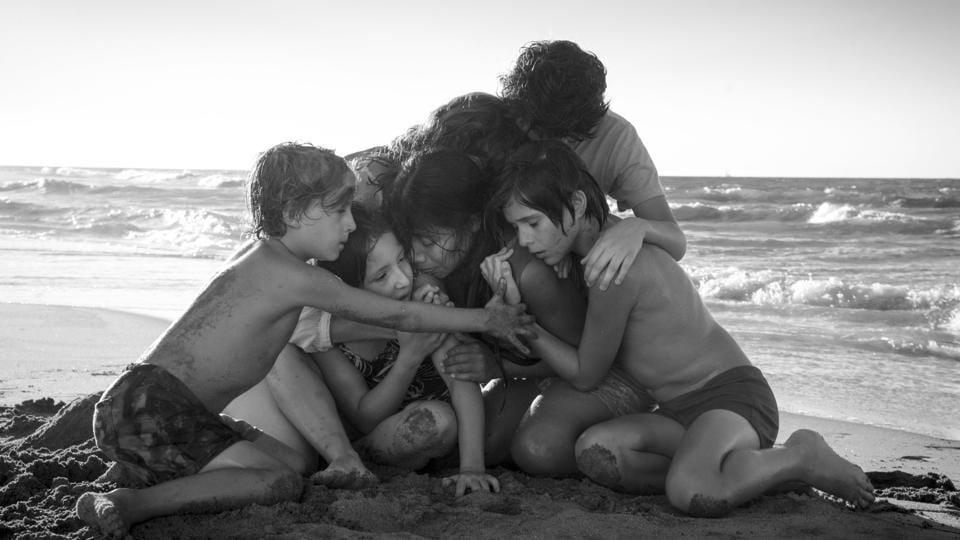 This image released by Netflix shows Yalitza Aparicio, centre, in a scene from the film Roma, by filmmaker Alfonso Cuaron.
