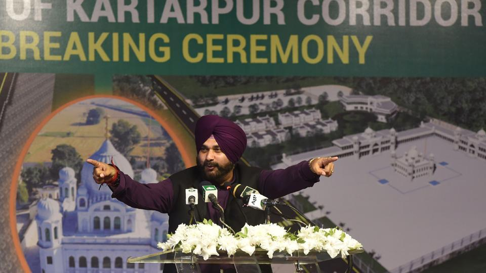 Punjab cabinet minister and former cricketer Navjot Singh Sidhu addresses the groundbreaking ceremony for the Kartarpur Corridor in Kartarpur on November 28, 2018.  Pakistan Prime Minister Imran Khan launched the ceremony of the religious corridor between India and Pakistan. (Arif Ali / AFP)