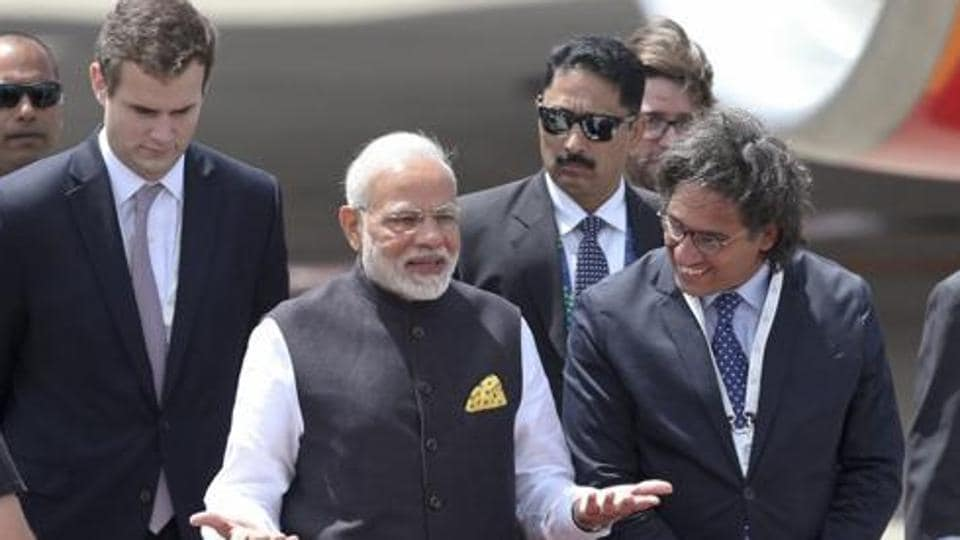 PM Narendra Modi gestures after he was welcomed by Argentina's Justice Minister German Garavano, right, upon his arrival at the Ministro Pistarini international airport to attend the G20 Summit in Buenos Aires, Argentina on Thursday, November 29, 2018.