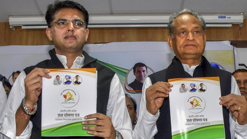 Jaipur: Rajasthan Congress chief Sachin Pilot and former Rajasthan chief minister and Congress general secretary Ashok Gehlot release the party manifesto for the Rajasthan Assembly elections 2018, in Jaipur, Thursday, Nov. 29, 2018. (PTI Photo)(PTI11_29_2018_000016B)
