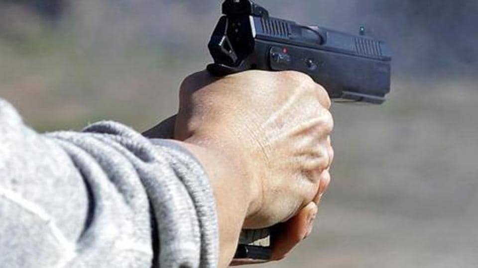 The alleged murderer was on a motorcycle with two associates in Najafgarh when he spotted the victim at a travel agent's office. The trio barged inside the office and the gangster shot him in his mouth at point blank range.