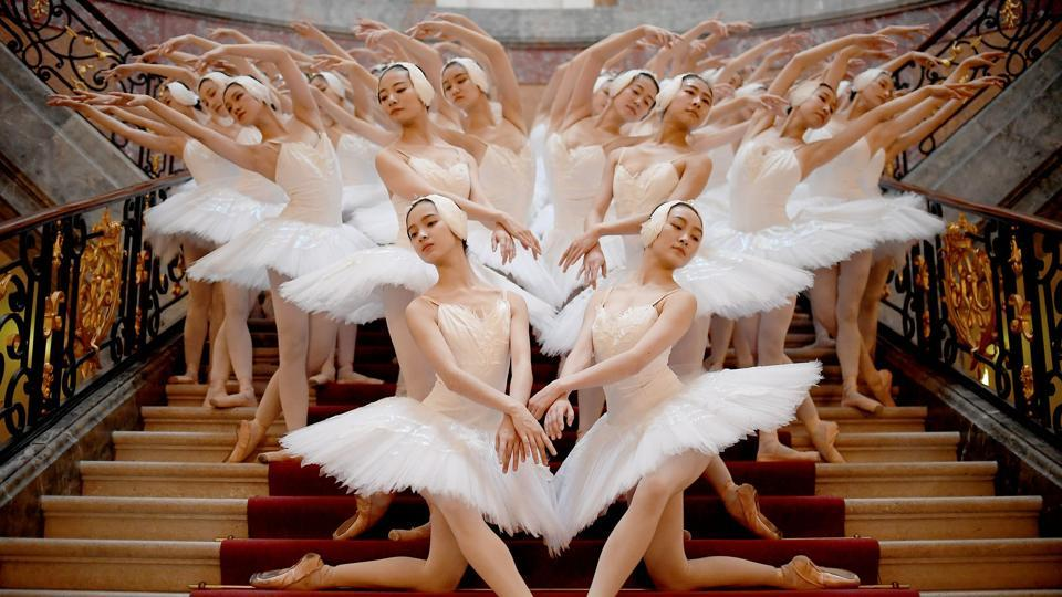 Dancers of the Shanghai Ballet show a choreography at the Bode museum in Berlin, Germany. The German premiere takes place on December 1, 2018. (Britta Pedersen / dpa / AFP)