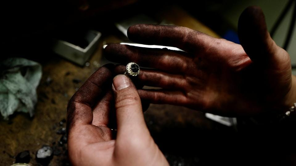 "Katarzyna Depa, 26, who makes jewellery from coal, holds a silver ring at her atelier in Katowice, Poland. ""For me using coal in a different way than it used to be, which was energy, shows its completely new face, so we can call it our new, cool black gold,"" said Depa. (Kacper Pempel / REUTERS)"