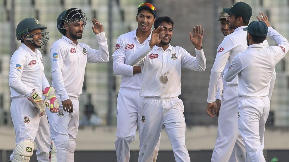 Bangladesh's Mehedi Miraz (C) celebrate with teammates after the dismissal of West Indies Shai Hope.