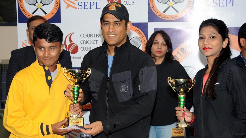 Ranchi: Former Indian cricket team captain MS Dhoni gives away a trophy to the winner of a tennis match at Jharkhand State Cricket Association (JSCA) International Cricket stadium, in Ranchi.
