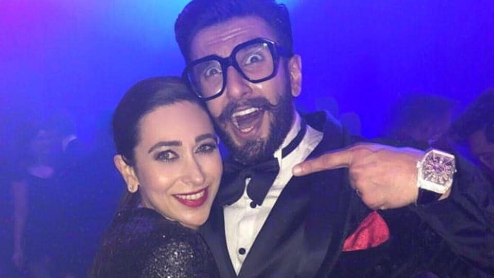 Ranveer looks happy as he poses with Karisma Kapoor at the party. They even danced together.
