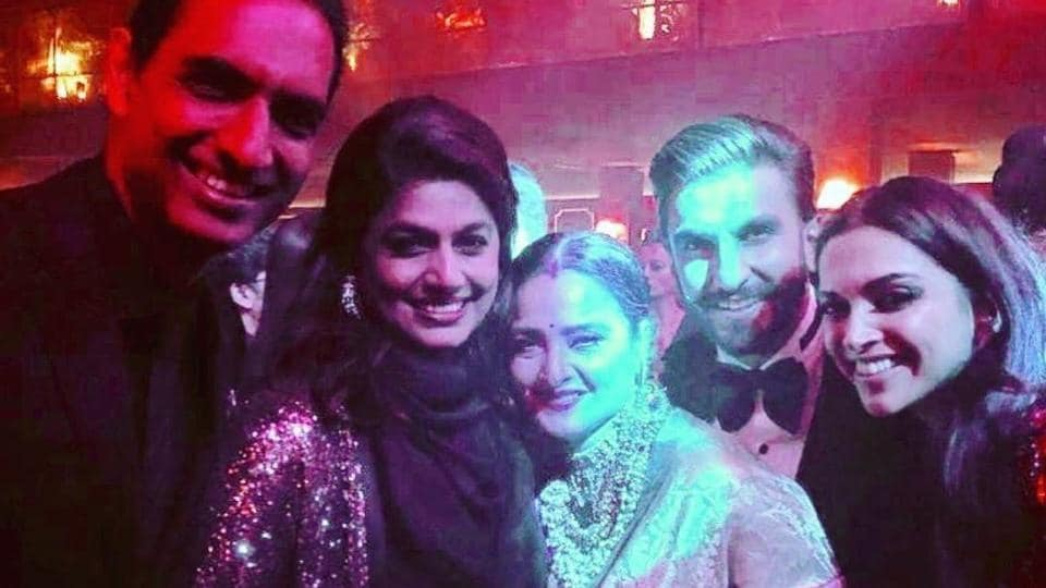 Deepika and Ranveer pose with Rekha. Deepika has always been close with the veteran actor.