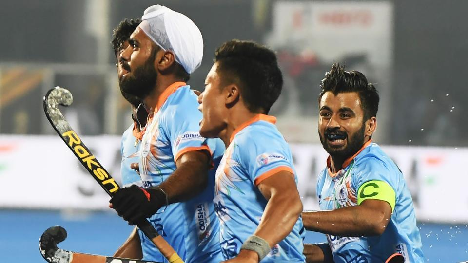 India's Simranjeet Singh (L) with teammates celebrate after scoring a goal against Belgium.