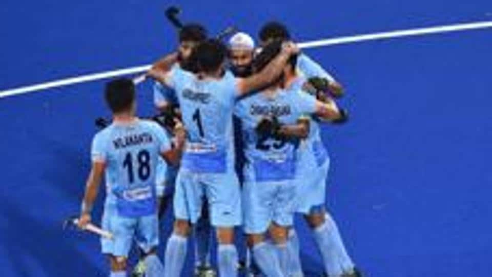 Simranjeet Singh of India celebrates with teammates after scoring during the FIH Men's Hockey World Cup Pool C match between India and South Africa at Kalinga Stadium.