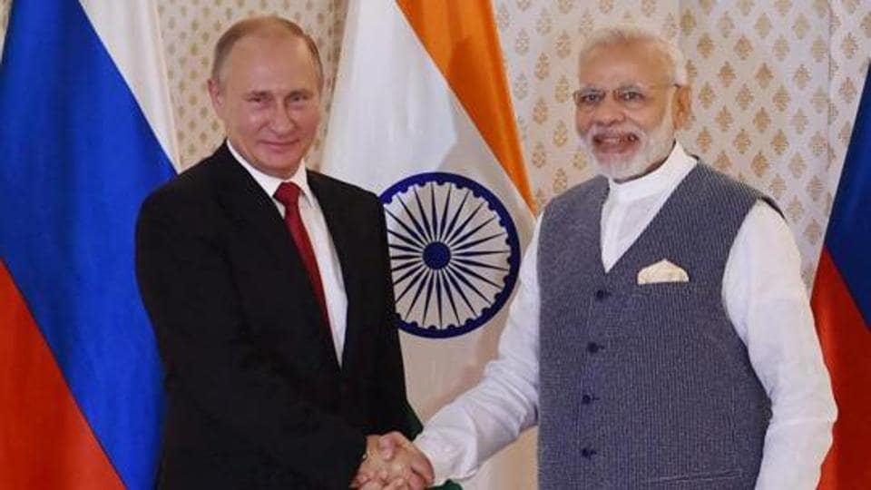 Russian President Vladimir Putin being welcomed by Prime Minister Narendra Modi ahead of 17th India-Russia annual summit meet in Goa. India has signed up for massive military purchases from Russia, including S-400 missiles and warships.