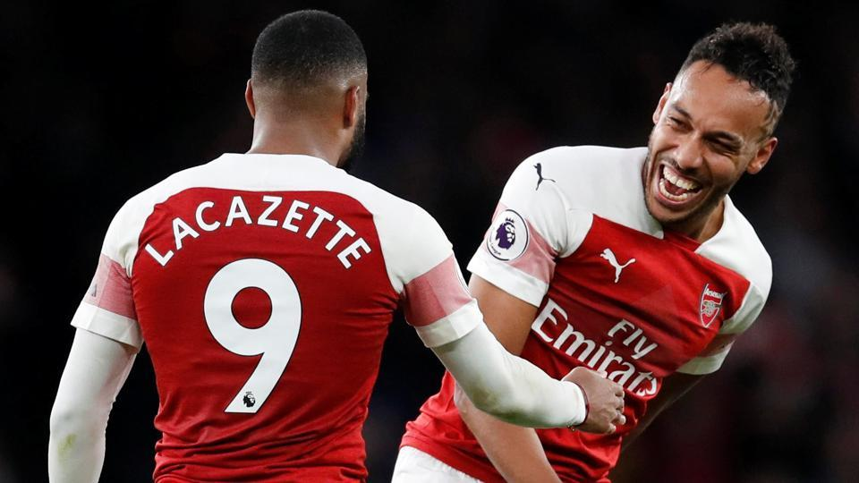 Arsenal's Alexandre Lacazette and Pierre-Emerick Aubameyang celebrate after the match.