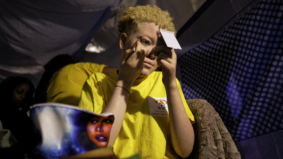 Kenyan contestant Lucianah Nyawira, 21, does her makeup as she prepares to perform in the Mr. & Miss Albinism East Africa contest, in Nairobi, last Friday. The aim of the event was to encourage confidence, affirm the dignity and promote inclusion of people who remain the target of sometimes deadly stigma in Africa. (Ben Curtis / AP)