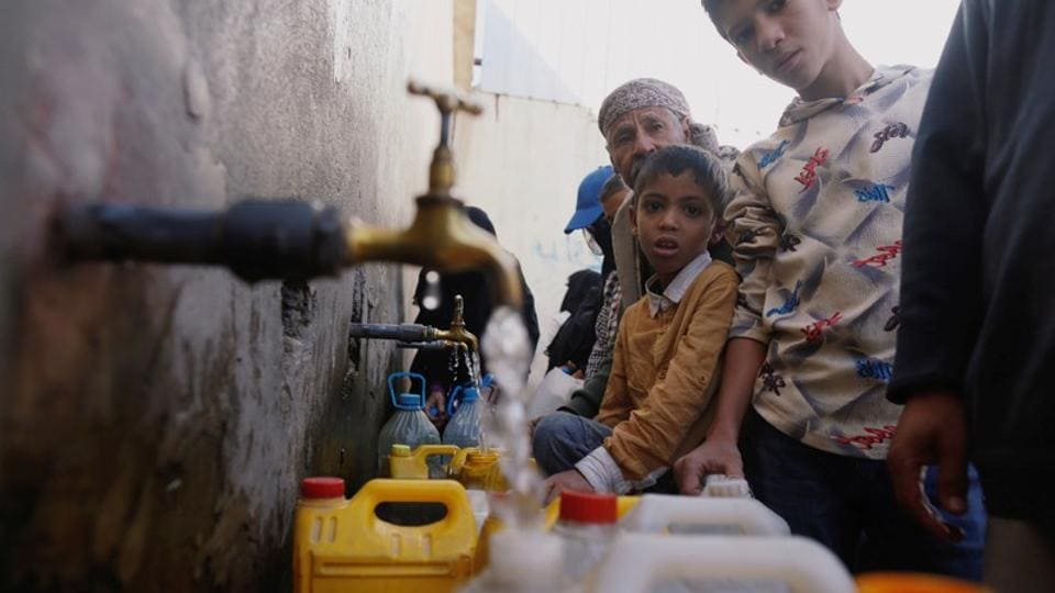 People collect drinking water from charity tap in Sanaa. Authorities in the Houthi-held Yemeni capital are sterilizing water supplies to help stem the world's worst outbreak of cholera. Nearly four years of war between a Saudi-led coalition and the Iran-aligned Houthis have crippled healthcare and sanitation systems. Some 1.2 million suspected cholera cases have been reported since 2017, with 2,515 deaths. (Khaled Abdullah / REUTERS)