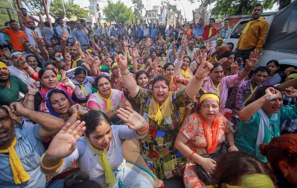 Kashmiri Pandits took out a protest march in Anantnag Sunday demanding that a passage