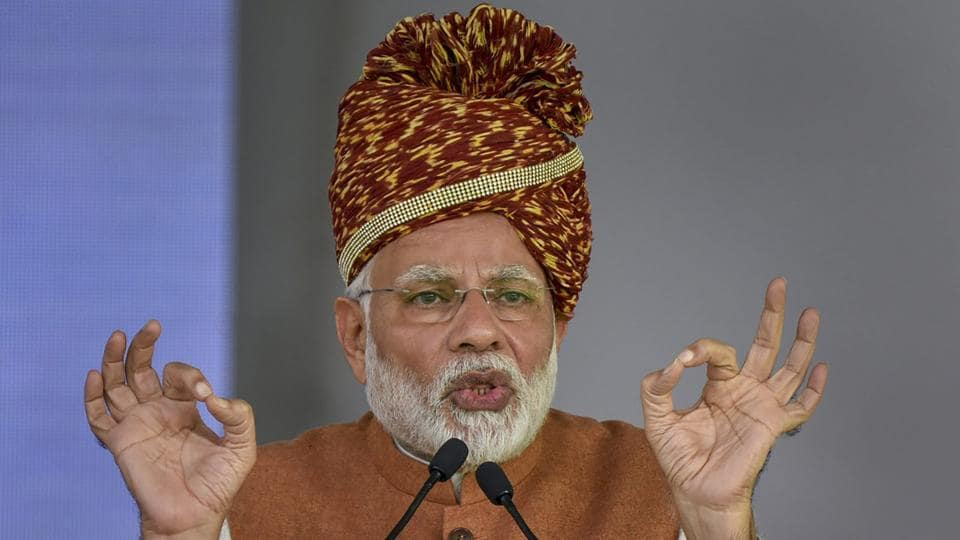 Referring to Rahul Gandhi's remarks on understanding of Hinduism made in Udaipur on Saturday, Prime Minister Narendra Modi, while addressing a public meeting at Jodhpur in Rajasthan, said that the state isn't going to vote whether Modi knows about Hinduism or not. Instead, he said, the state will vote on the topic of electricity, water, development. (PTI)