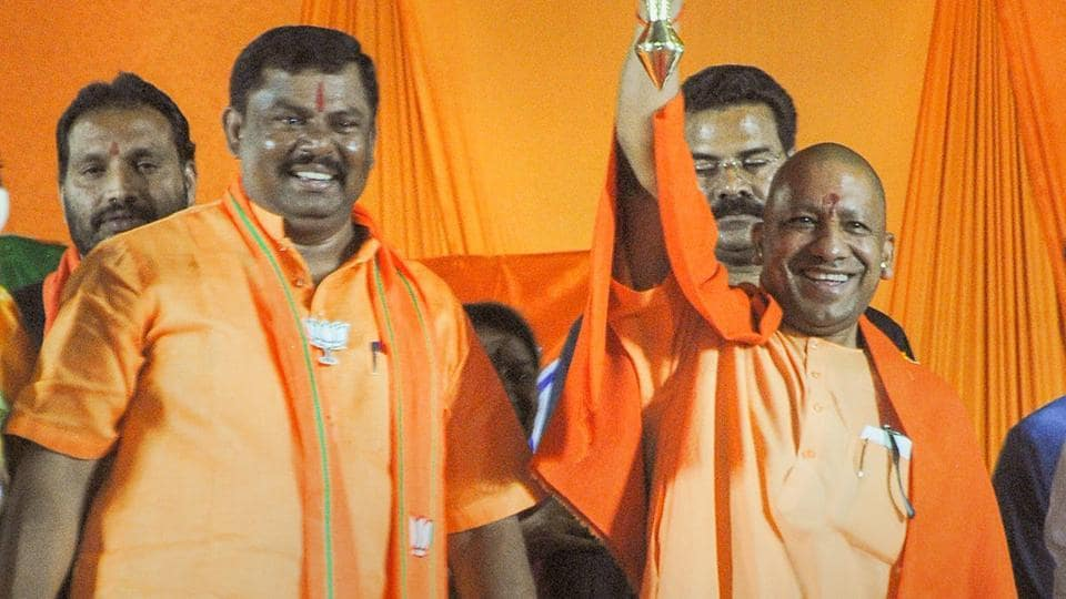 Yogi Adityanath (right) was addressing an election rally in Goshamahal constituency in Hyderabad in support of BJP candidate T Raja Singh Lodh (left).
