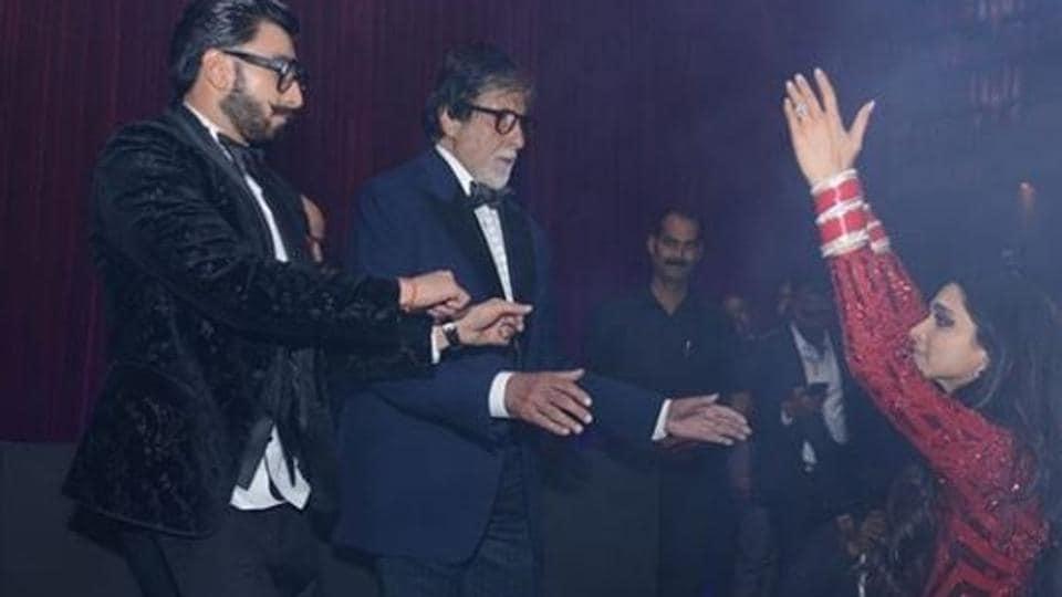 Amitabh Bachchan and Ranveer Singh dance with Deepika Padukone.