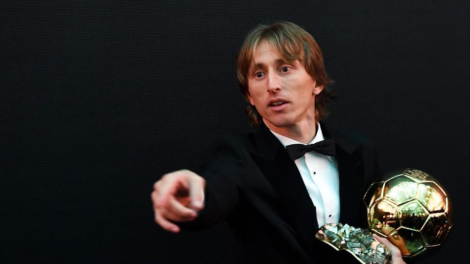 2018 FIFA Men's Ballon d'Or award for best player of the year's Real Madrid's Croatian midfielder Luka Modric poses with the trophy after the 2018 FIFA Ballon d'Or award ceremony at the Grand Palais in Paris.