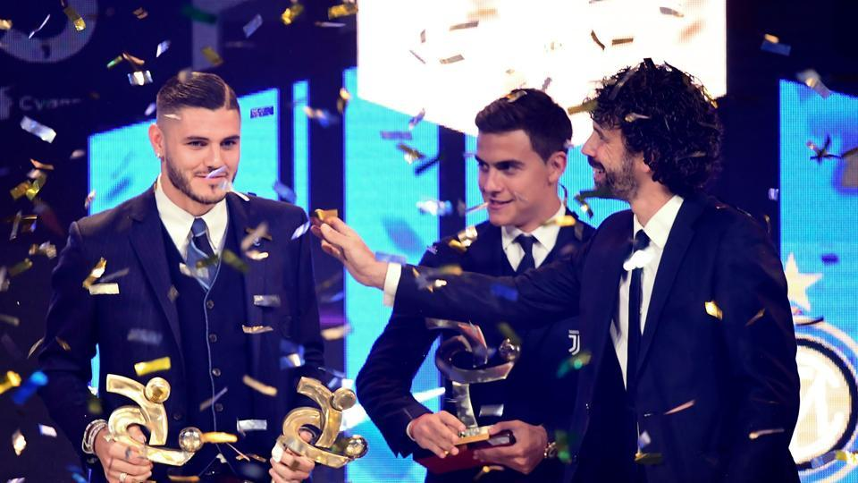 Inter's Argentinian forward Mauro Icardi (left) receives from AIC President Damiano Tommasi (right) the award for the best player of 2018.