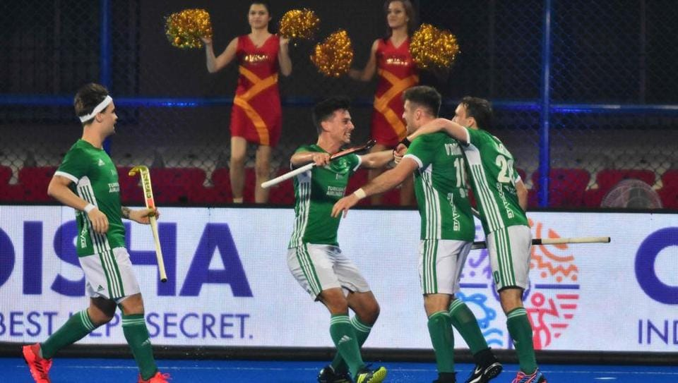 Ireland's player Shane O'Donoghue (2R) celebrates with teammates after scoring a goal during the field hockey group stage match between Australia and Ireland at the 2018 Hockey World Cup in Bhubaneswar on November 30, 2018
