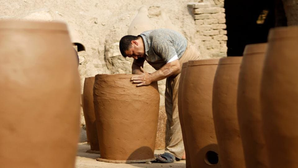 """The income of most families did not allow them to buy a refrigerator or freezer to keep their water cold, so most used clay cauldrons,"" he said. Back then, his family sold their large jugs in bulk -- sometimes thousands per week across every Iraqi province. But times have changed. (Haidar Hamdani / AFP)"