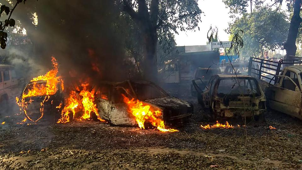 Vehicles set on fire by a mob during a protest over the alleged illegal slaughter of cattle, in Bulandshahr on Monday, December 03, 2018. According to Additional Director General of Meerut zone Prashant Kumar, protesters from Mahaw village and nearby areas pelted stones on the police and indulged in arson setting several vehicles and the Chingarwathi Police Chowki on fire.