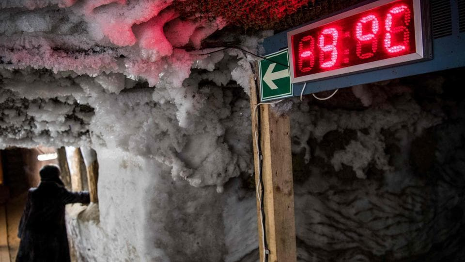An electronic thermometer shows the temperature in the Museum of the History of Permafrost Studies located beneath the Melnikov Permafrost Institute Yakutsk, Russia. This city, one of the coldest on Earth, is hit by dangerous melting of its frozen ground, or permafrost, on which buildings stand. Average temperatures here have risen by 2.5 degrees Celsius over the past decade. (Mladen Antonov / AFP)
