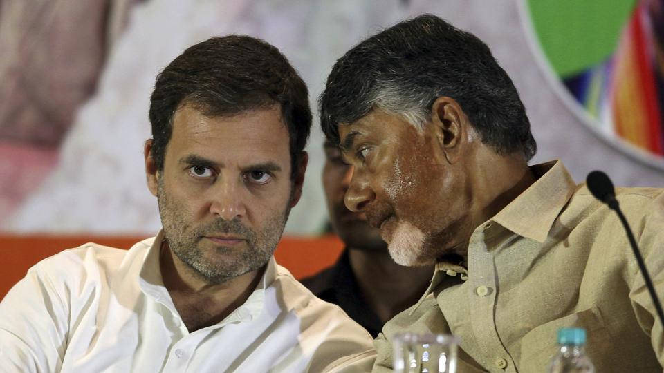 Congress party President Rahul Gandhi, left, listens to Telugu Desam Party (TDP) President and Andhra Pradesh Chief Minister N Chandrababu Naidu during a press conference in Hyderabad on Wednesday.