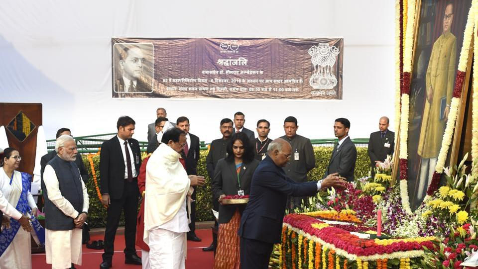 President Ram Nath Kovind, Vice President M. Venkaiah Naidu and Prime Minister Narendra Modi on Thursday paid floral tributes to Babasaheb B.R. Ambedkar, on his 63rd death anniversary at a function in Parliament House Lawns, New Delhi. Lok Sabha Speaker Sumitra Mahajan, other MPs and political leaders, also paid homage to the Father of the Indian Constitution, who championed the causes of Dalits, women and labourers. (Arvind Yadav / HT Photo)