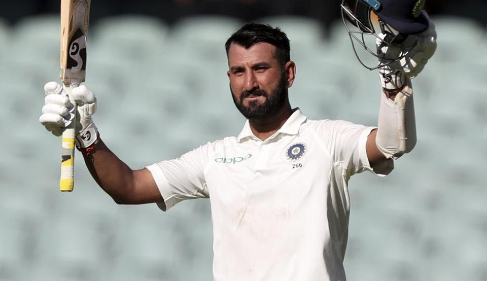 Cheteshwar Pujara celebrates after reaching a century during the first Test between Australia and India in Adelaide. (AP)