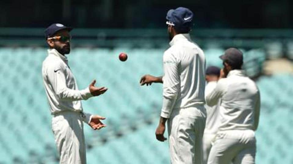 India's captain Virat Kohli (L) throws the ball to Lokesh Rahul (C) whilst fielding on the fourth day of the tour match against Cricket Australia XI at the SCG in Sydney.
