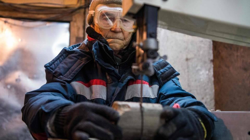 In the Permafrost Institute's underground labs -- a network of ice-covered tunnels and rooms dug in the permafrost -- scientists and engineers are developing improved construction techniques and ways to keep the ground frozen as the atmosphere warms. (Mladen Antonov / AFP)