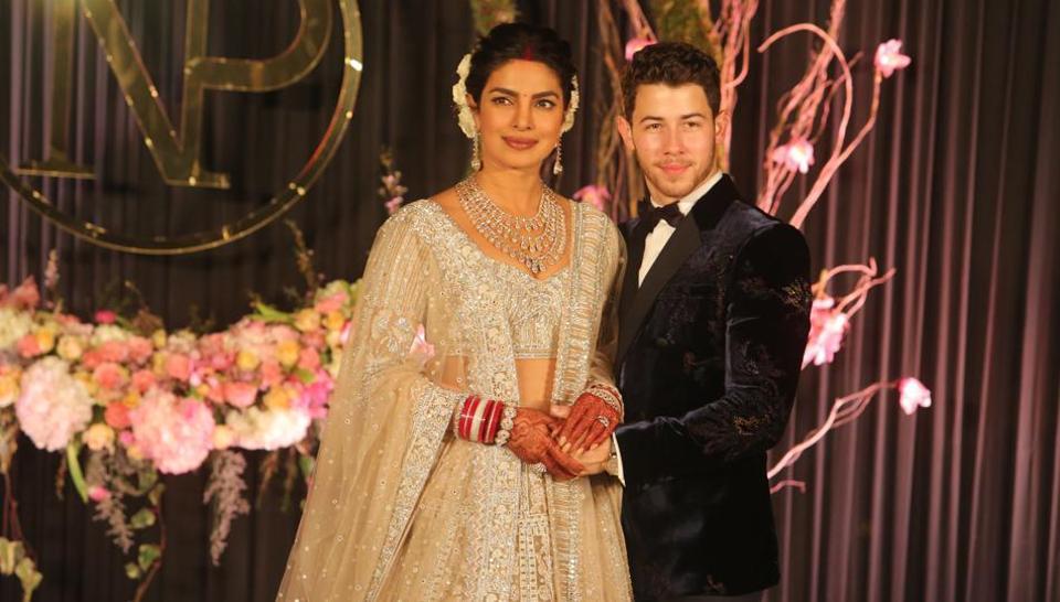 Newly-wed Bollywood actor Priyanka Chopra and American singer Nick Jonas pose for photos during their wedding reception, at Taj Palace, in New Delhi. (Photo By Manoj Verma/ Hindustan Times)
