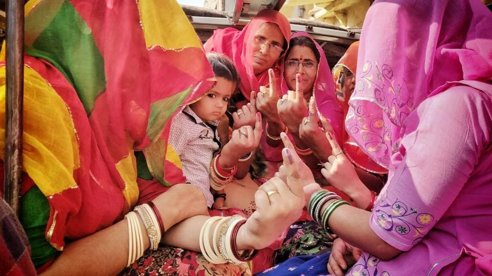 Women seated in a vehicle show their inked finger after casting their vote at a polling booth in Japipur, Rajasthan. Till 1 pm the voter turnout was recorded 41.53%. In Ahor, EVMs malfunctioned where as Sikar's Fatehpur witnessed clashes between two groups in which vehicles were set on fire and vandalised. (Himanshu Vyas / HT Photo)