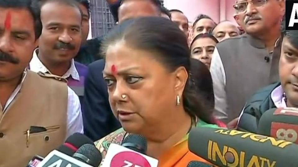 Rajasthan Chief Minister Vasundhara Raje speaks to reporters after casting her vote on Friday.