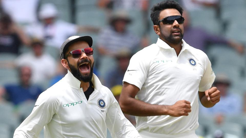 India's captain Virat Kohli and his teammate Ravichandran Ashwin celebrate the dismissal of Australia's Marcus Harris. (REUTERS)
