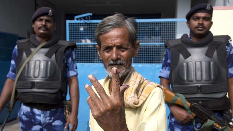 An Indian displays the indelible ink mark on his index fingers after casting his vote in Hyderabad, India, Friday, December 7, 2018. This is the first state elections in Telangana after it was formed bifurcating Indian state of Andhra Pradesh.