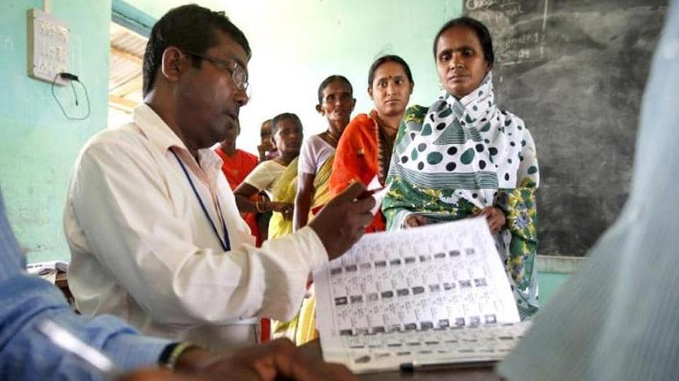 Women wait for their turn to cast votes.