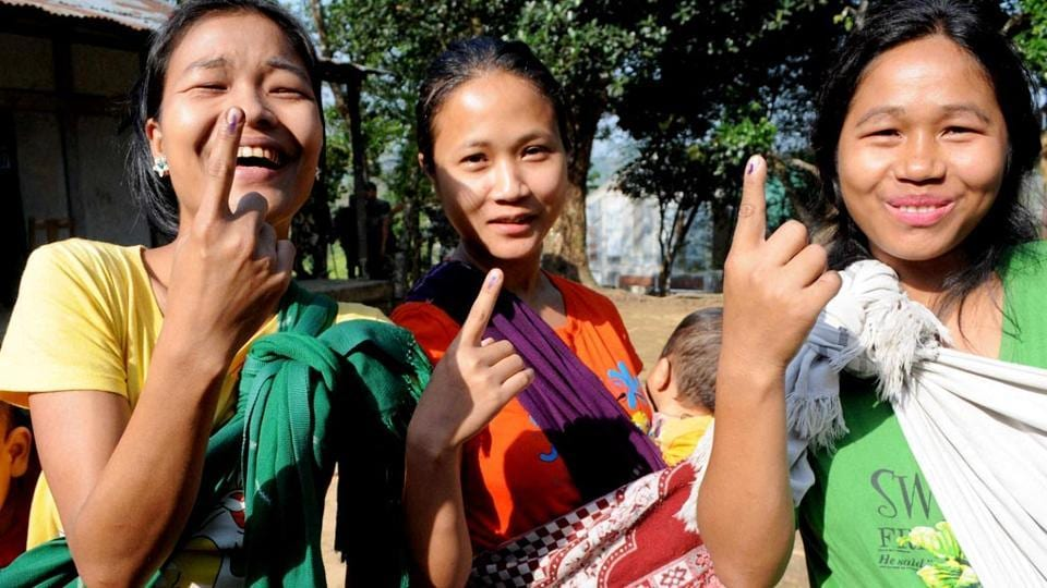 Young-girls-show-their-marked-fingers-after-casting-votes-for-Lok-Sabha-polls-at-a-polling-station-in-Aizawl-Mizoram