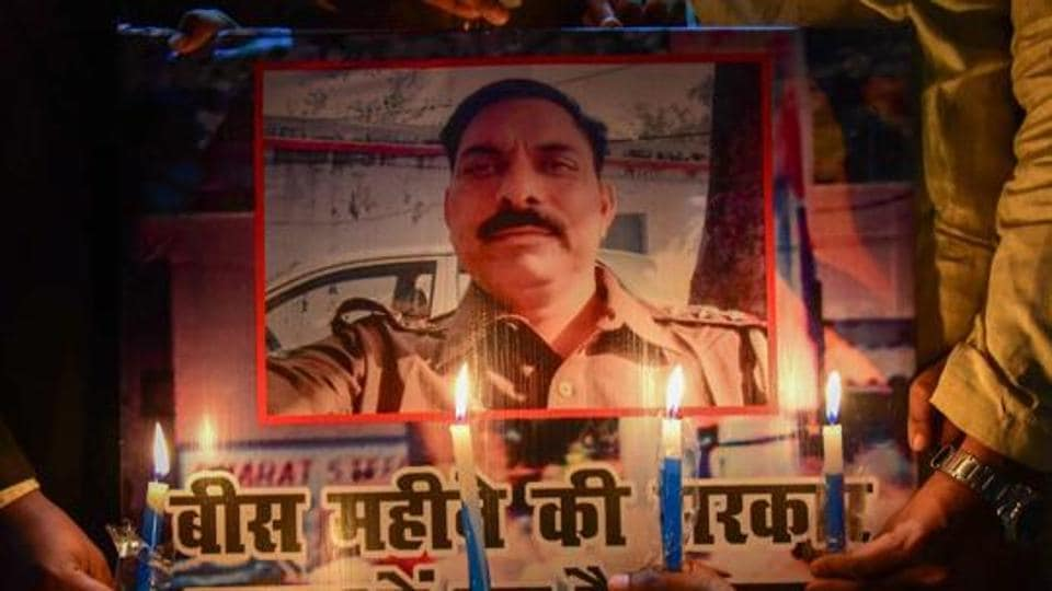 Allahabad: Samajwadi Party workers take part in a candle light march to pay tribute to police inspector Subodh Singh, who was killed in Monday's mob violence in Bulandshahr, in Allahabad.