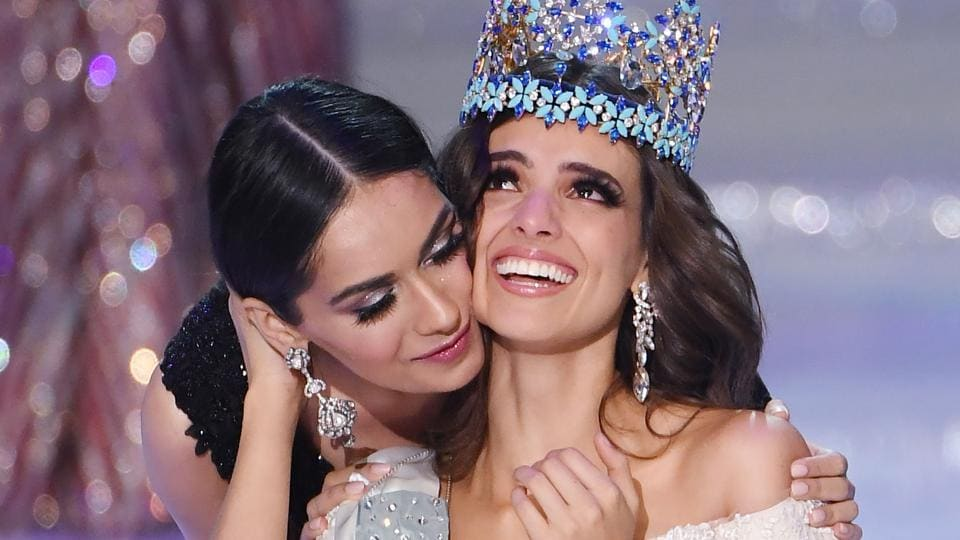 Miss Mexico Vanessa Ponce de Leon (right) reacts as she is crowned the 68th Miss World by Miss World 2017 Manushi Chhillar in Sanya, on the tropical Chinese island of Hainan on December 8, 2018.